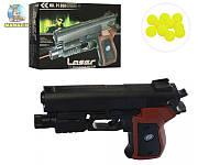 Игрушечный пистолет на пульках с лазерным прицелом