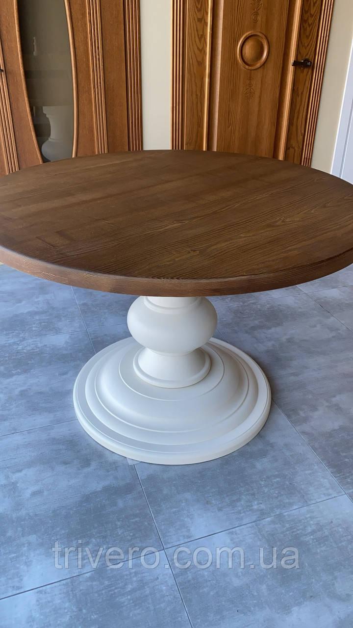 Круглий стіл з великою опорою з масиву дерева