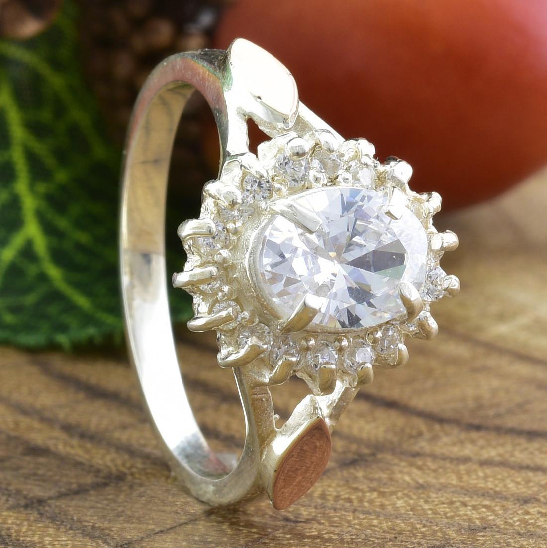 Серебряное кольцо с золотом Асти вставка белые фианиты вес 3.54 г размер 16