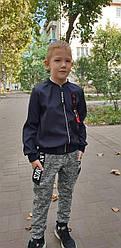 Теплые  спортивные штаны на мальчика 152 см