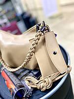 Жіноча сумка світло-бежевого кольору, з м'якою еко шкіри