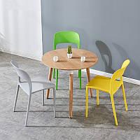 Желтый пластиковый стул Ostin для баров, кафе, ресторанов, стильных квартир