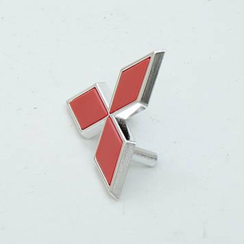"Емблема ""Mitsubishi"" 64х55мм\пластик\червоний\2 пукли (мала)"