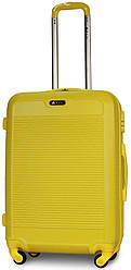 Валіза пластикова на 4х колесах середня M жовта   25х65х42 см   3.150 кг   62 л   FLY 1093