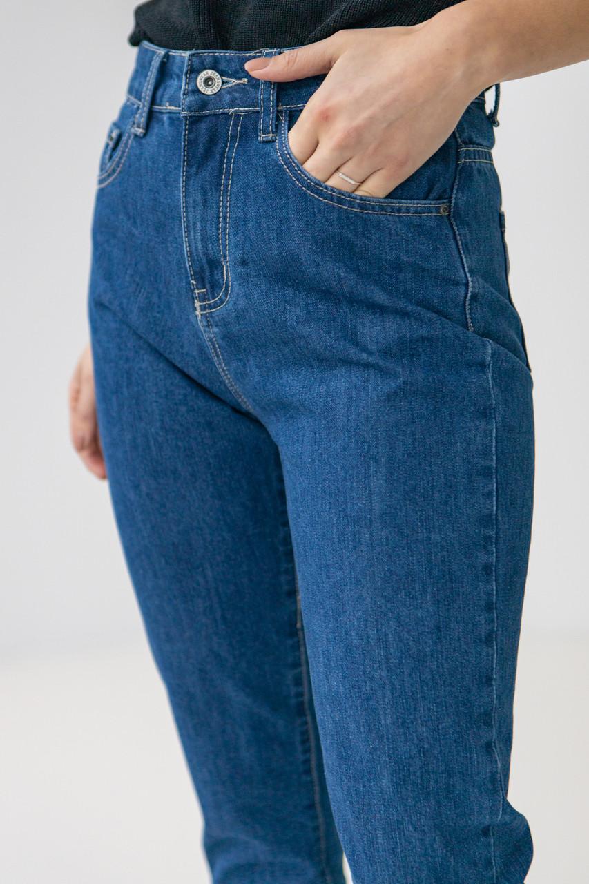 Базові темно-сині джинси з високою посадкою в розмірах: S, M, L, XL.