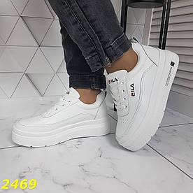Кросівки-кеди на високій масивній платформі білі