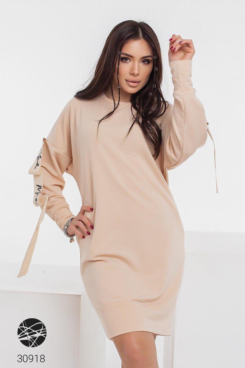 Трикотажное платье с боковыми карманами и отделкой лентой с 42 по 48 размер