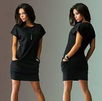 Черное женское трикотажное платье с карманами