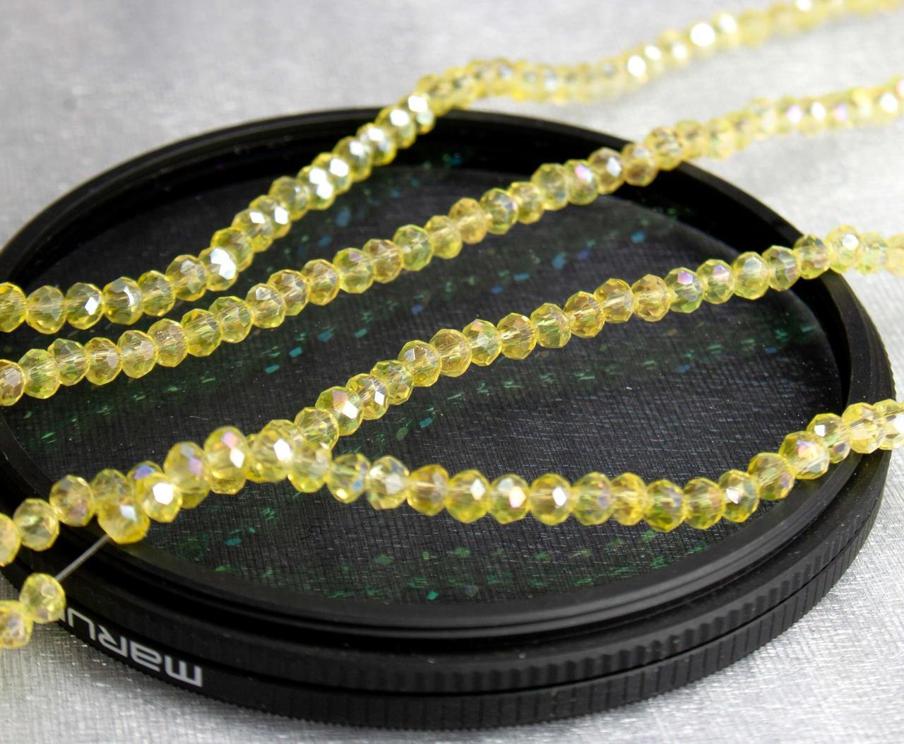 Кришталеві намистини 2х2мм кількість: 180-190 шт, жовтий прозорий з АБ