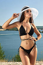 Пляжный женский раздельный купальник с рюшами и декоративными завязками. Черный