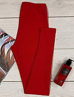 Червоні жіночі лосини для відпочинку та спорту.