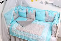 Комплекти в дитячу кроватку з бортиками подушками