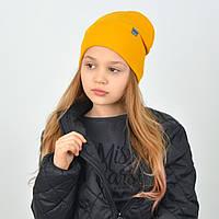 Яскрава дитяча шапка демісезонна гірчичного кольору