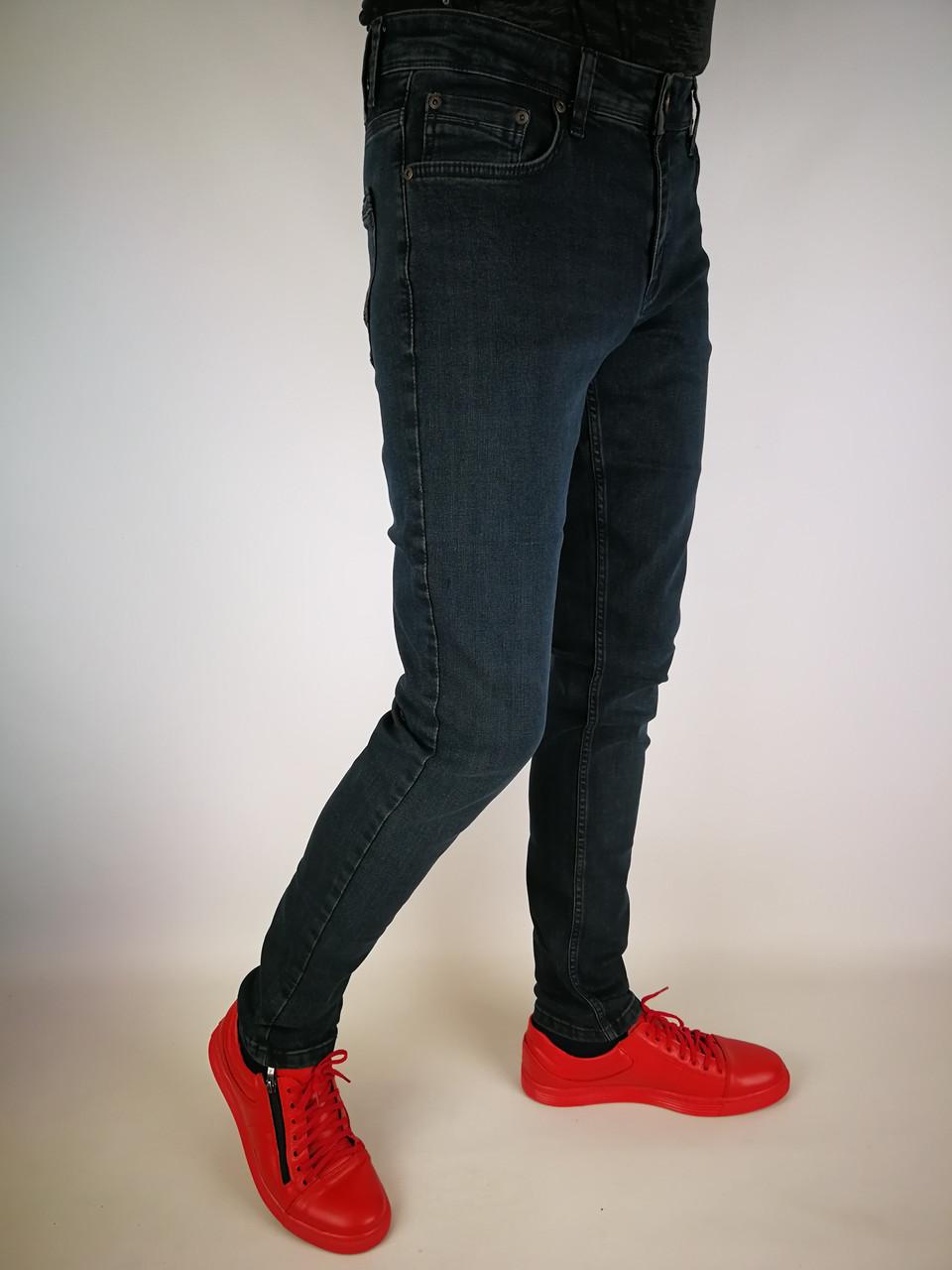 Завужені чоловічі джинси