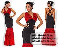 Красивое нарядное женское платье с кружевным лифом и пышной юбкой черное