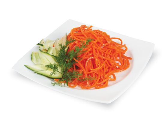 морковка по корейски приготовлена универсальной теркой вид сверху