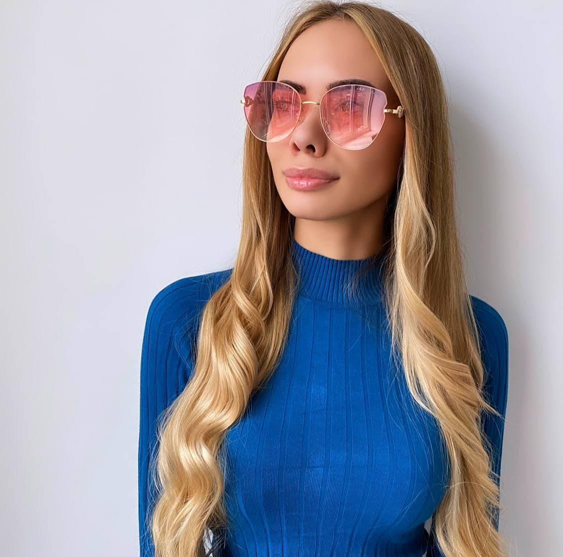 Жіночі сонцезахисні окуляри рожеві