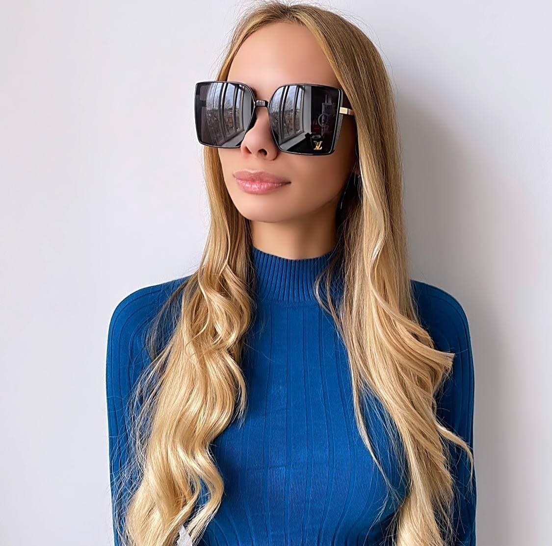 Жіночі чорні сонцезахисні окуляри