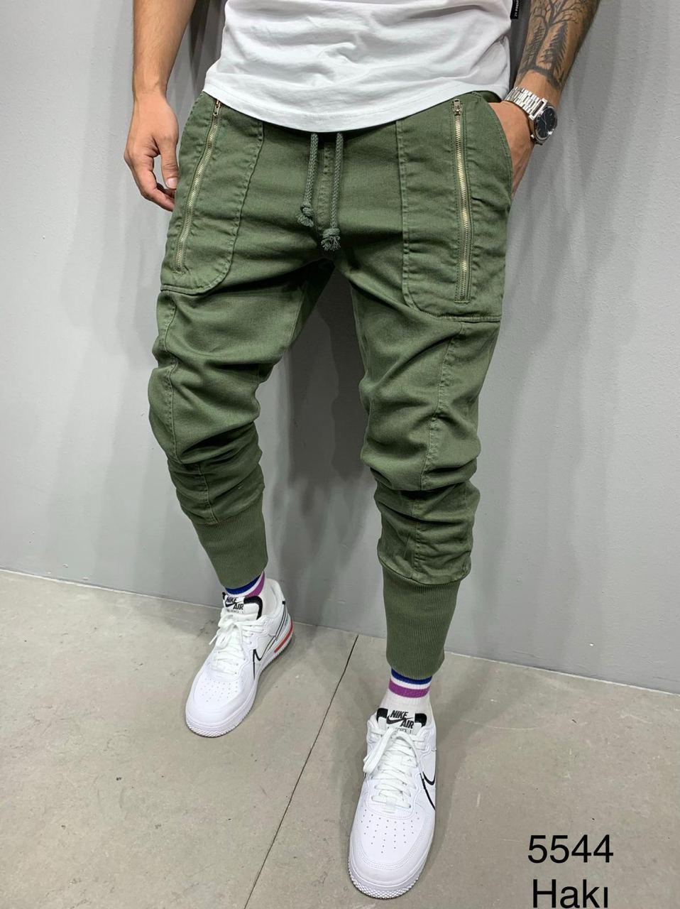 Джинсы мужские зеленые стильные с карманами на манжетах