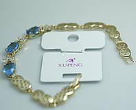 Пленительный браслет с голубыми кристаллами. Шикарные позолоченные браслеты для женщин Xuping оптом. 33
