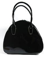 Женская лаковая сумка закругленная