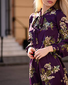 Легке літнє плаття жіноче з рюшами і бантом середньої довжини