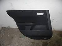 Оббивка двери зад. лев. (Седан) Renault Megane II 03-06 (Рено Меган 2), 8200277934