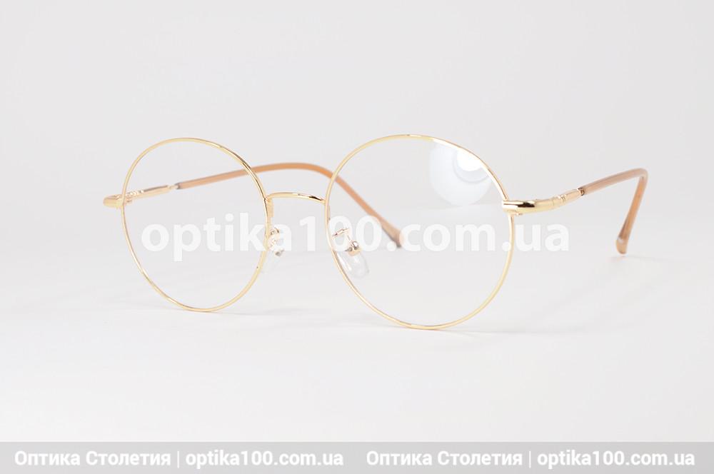 Женская круглая золотистая оправа очков
