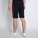 Чоловічі трикотажні шорти PUMA, темно-синього кольору., фото 2