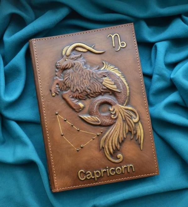 """Ежедневник А5 формата в кожаной обложке c художественным объемным тиснением ручной работы """"Козерог"""""""
