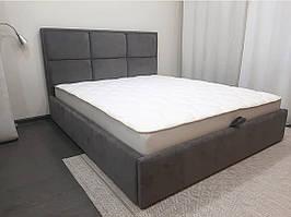 Двуспальная кровать с мягким изголовьем в виде прямоугольников и квадратов