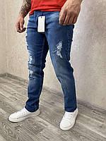 Сині чоловічі рвані джинси