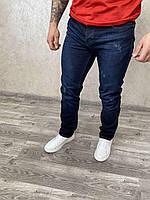 Темно сині приталені джинси
