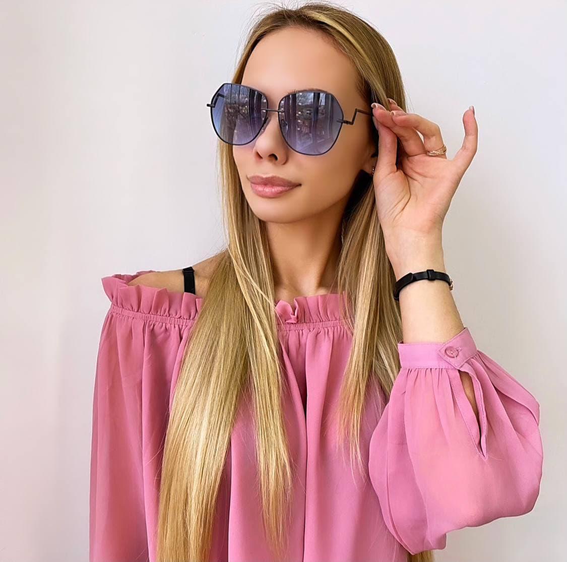 Жіночі сонцезахисні окуляри з темними металевою оправою