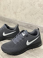 Топові сірі кросівки найк