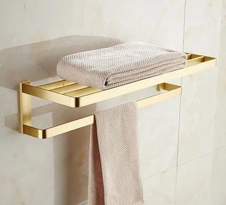 Золоті вішалки для рушників у ванну кімнату