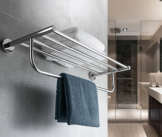 Хромові і білі вішалки для рушників у ванну кімнату