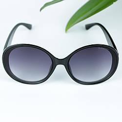 Коричневі жіночі сонцезахисні окуляри