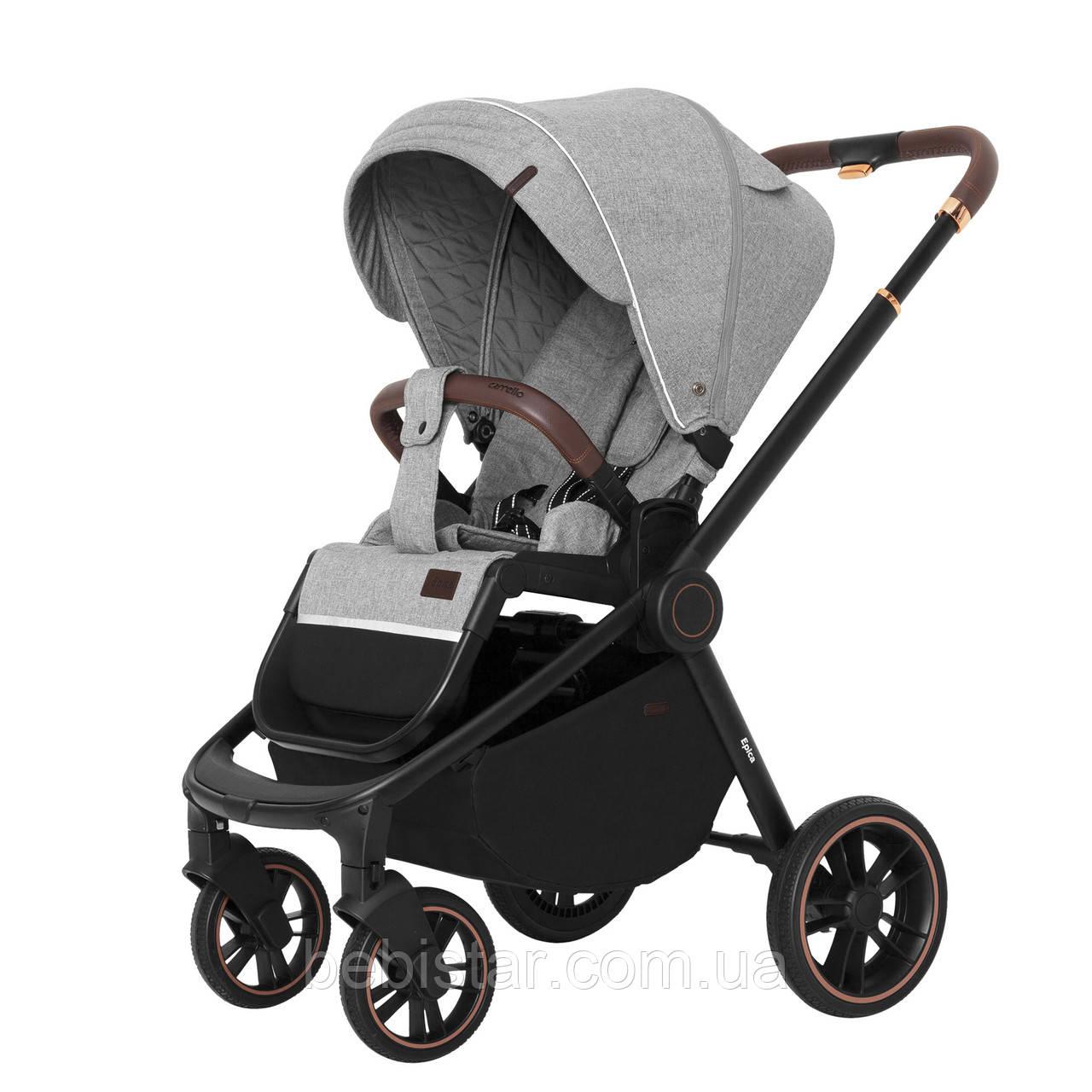 Прогулочная детская коляска серая Carrello Epicа черная рама утепленный чехол на ножки дождевик
