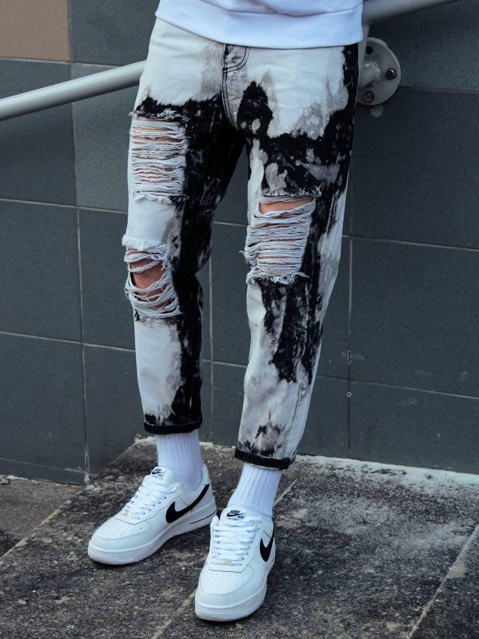 Мужские джинсы бело-черного цвета рваные