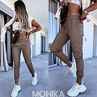 Жіночі стильні брюки з еко-шкіри на манжетах Норма