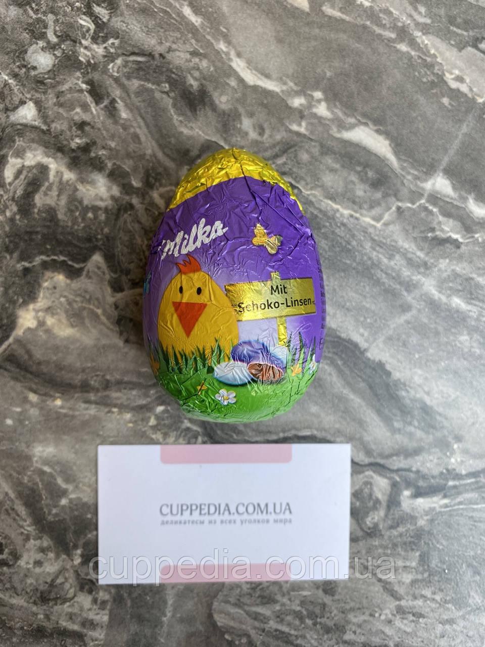 Шоколадне яйце Milka Mit Schoko - Linsen 50 грм
