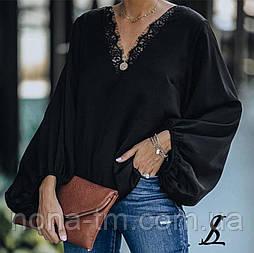 Жіноча модна блузка вільного крою