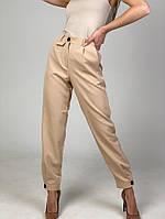 Жіночі стильні брюки з манжетами