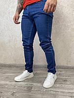 Приталені чоловічі темно сині джинси