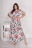 Женское легкое платье с воланами, широкого и свободного кроя, на спинке завязывается на бантик.