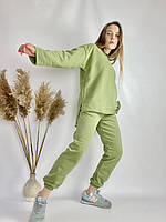 Зелений спортивний жіночий костюм з подовженою кофтою з бавовни розмір S-M