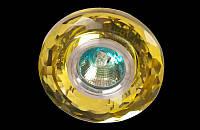 Точечный светильник жёлтого цвета
