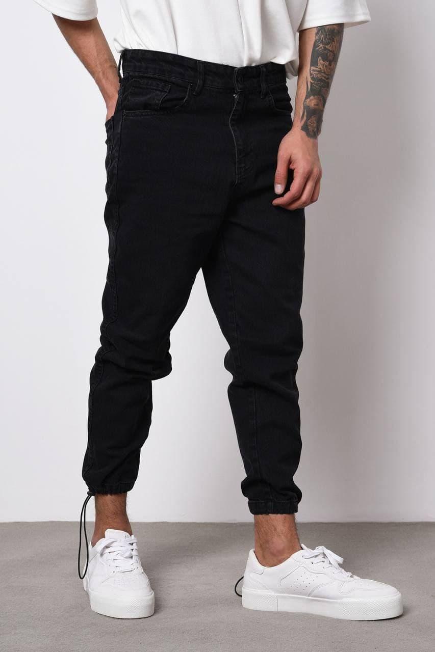Чоловічі джинси-джоггеры чорного кольору під манжет