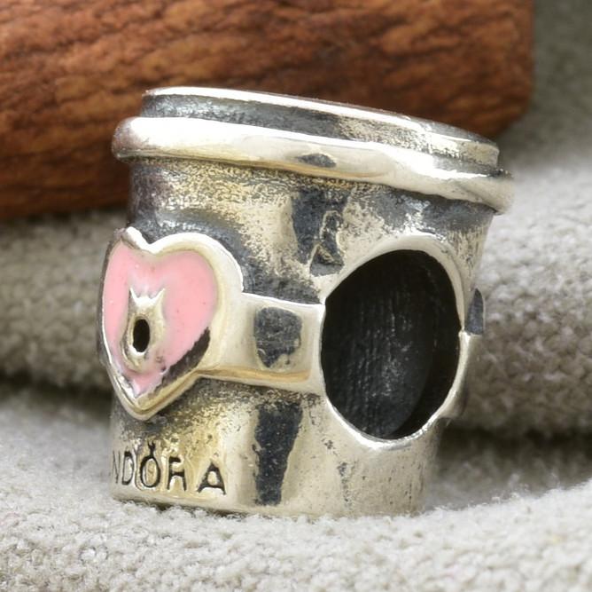Серебряный шарм 10х8 мм белая эмаль вес серебра 2.5 г